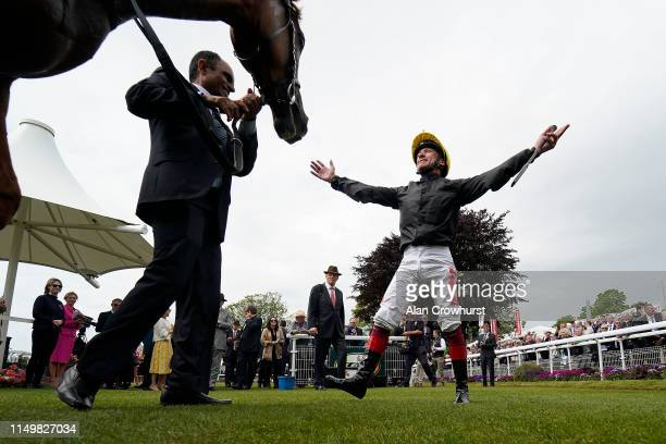 Frankie Dettori celebrates after riding Stradivarius to win The Matchbook Yorkshire Cup Stakes at York Racecourse on May 17, 2019 in York, England.