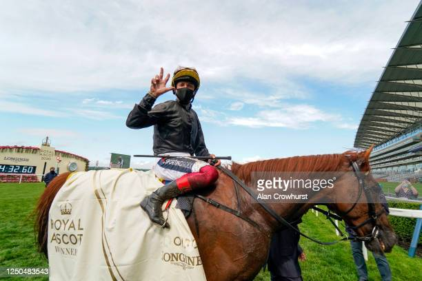 Frankie Dettori celebrates after riding Stradivarius to win The Gold Cup for the third time in a row on Day Three of Royal Ascot at Ascot Racecourse...