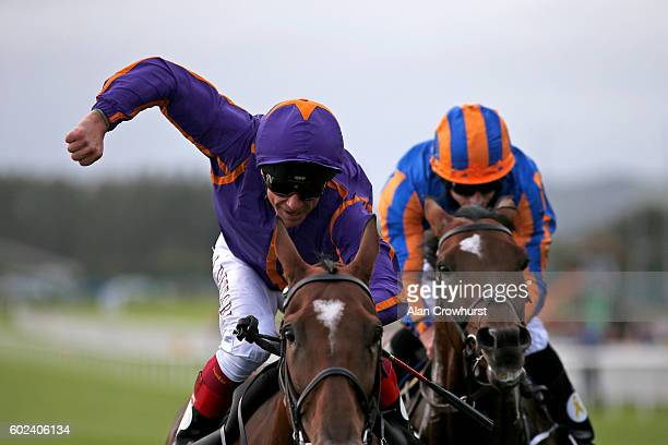 Frankie Dettori celebrates after riding Wicklow Brave to win The Palmerstown House Estate Irish St Leger from Order Of St George at Curragh...