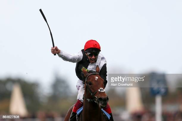 Frankie Dettori celebrates as he rides Cracksman to win The QIPCO Champion Stakes at Ascot racecourse on QIPCO British Champions Day on October 21...