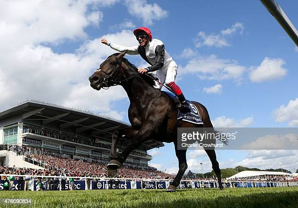 Frankie Dettori celebrates as he rides Golden Horn to win The Investec Derby at Epsom racecourse on June 06, 2015 in Epsom, England.