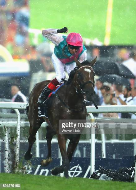Frankie Dettori celebrates riding Enable to victory in The Investec Oaks during the Investec Ladies Day at Epsom Downs Racecourse on June 2, 2017 in...