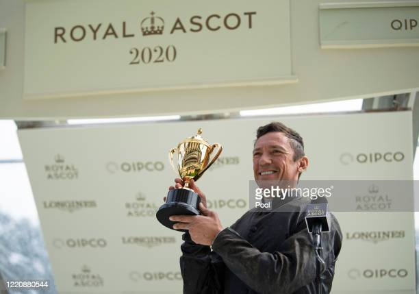 Frankie Dettori celebrates with the trophy after riding Stradivarius to win his third Gold Cup during Day Three of Royal Ascot 2020 at Ascot...