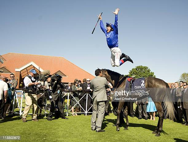 Frankie Dettori dismounts Blue Bunting after winning the Qipco 1000 Guineas Stakes at Newmarket racecourse on May 01, 2011 in Newmarket, England.