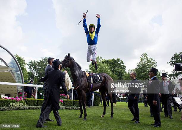 Frankie Dettori dismounts from Across The Stars after winning The King Edward VII Stakes Race run during Day Four of Royal Ascot at Ascot Racecourse...
