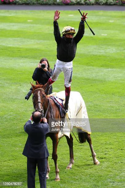 Frankie Dettori does a flying dismount from Stradivarius after winning the Gold Cup on Day Three of Royal Ascot 2020 at Ascot Racecourse on June 18,...
