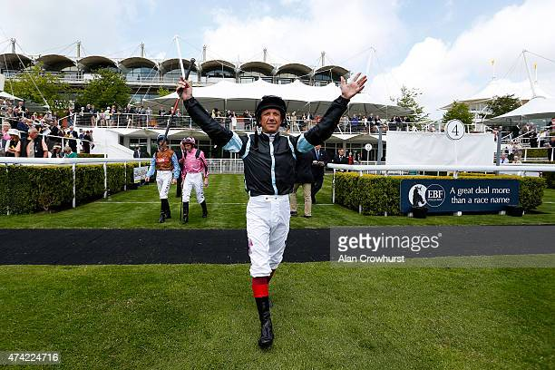 Frankie Dettori greets his connections as he enters the parade ring at Goodwood racecourse on May 21 2015 in Chichester England
