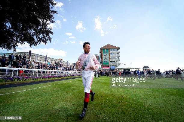 Frankie Dettori jogs back to the weighing room at York Racecourse on May 16, 2019 in York, England.