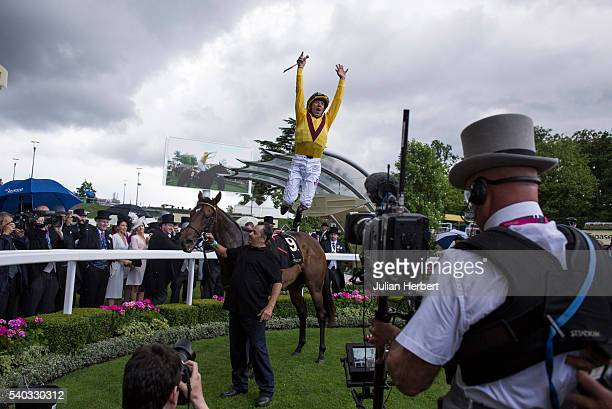 Frankie Dettori jumps from Lady Aurelia after winning The Queen Mary Stakes Race run during Day Two of Royal Ascot at Ascot Racecourse on June 15,...
