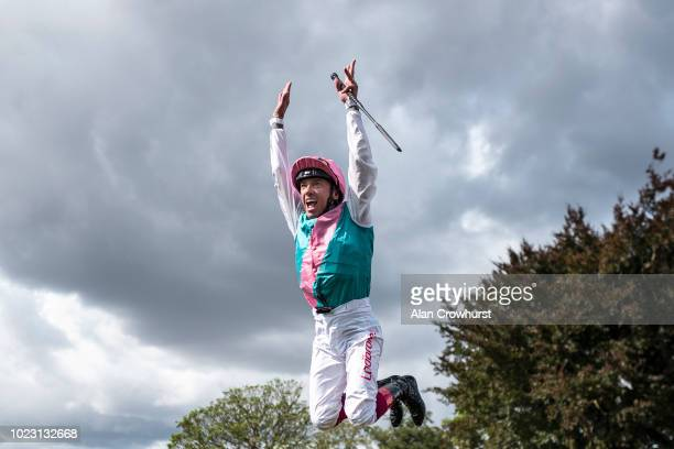 Frankie Dettori leaps from Expert Eye after winning The Sky Bet City Of York Stakes at York Racecourse on August 25, 2018 in York, United Kingdom.