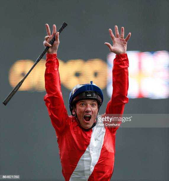 Frankie Dettori leaps from Persuasive after winning The Queen Elizabeth II Stakes at Ascot racecourse on QIPCO British Champions Day on October 21...