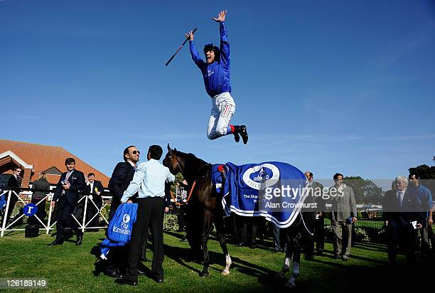 Frankie Dettori leaps off Lyric Of Light as he celebrates winning The Shadwell Fillies' Mile at Newmarket racecourse on September 23 2011 in...