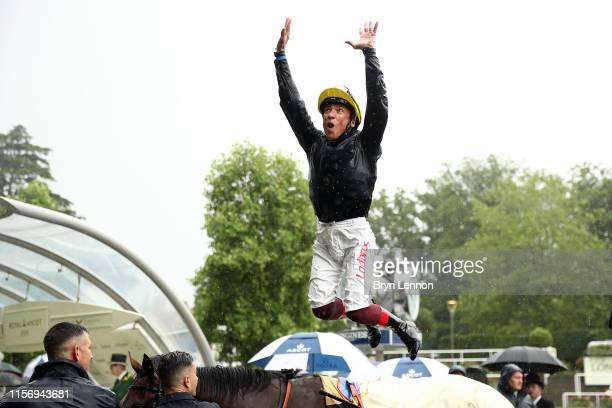 Frankie Dettori makes a flying dismount from Crystal Ocean after winning The Prince of Wales's Stakes on day two of Royal Ascot at Ascot Racecourse...