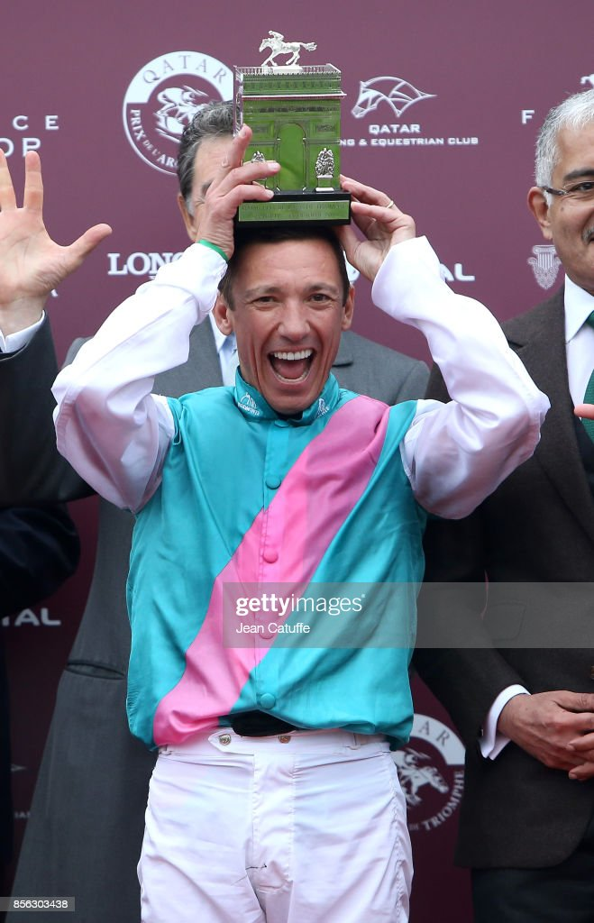 Frankie Dettori of Italy riding 'Enable' celebrates winning Qatar Prix de l'Arc de Triomphe 2017 at Hippodrome de Chantilly racecourse on October 1, 2017 in Chantilly France.