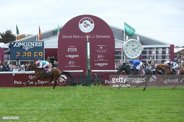 Frankie Dettori of Italy riding 'Enable' wins in front of second Mickael Barzalona riding 'Cloth of Stars' and third Jim Crowley riding 'Ulysses' the...