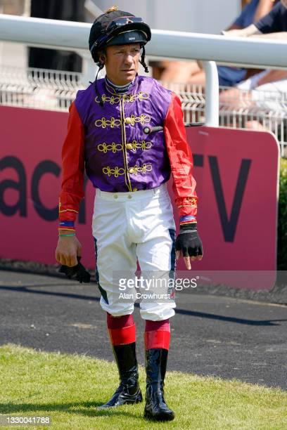 Frankie Dettori poses in the Queen's silks at Sandown Park Racecourse on July 22, 2021 in Esher, England.