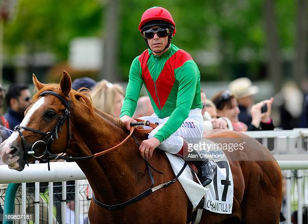 Frankie Dettori returns on First Cornerstone after finishing down the field in The Prix du Jockey Club at Chantilly racecourse on June 02 2013 in...