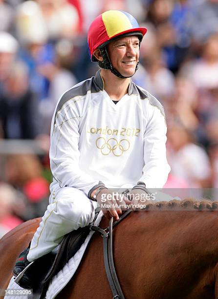 Frankie Dettori rides former race horse Monsignor prior to carrying the Olympic torch around the parade ring on day 53 of the London 2012 Olympic...