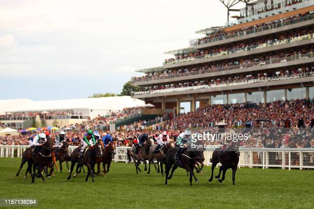 Frankie Dettori riding A'Ali leads the field on his way to winning the Norfolk Stakes on day three of Royal Ascot at Ascot Racecourse on June 20 2019...