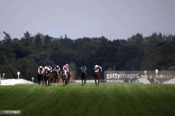 Frankie Dettori riding Advertise leads the field on his way to winning The Commonwealth Cup on day four of Royal Ascot at Ascot Racecourse on June...