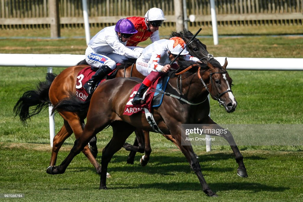 Frankie Dettori riding Advertise (R) win The Arqana July Stakes at Newmarket Racecourse on July 12, 2018 in Newmarket, United Kingdom.