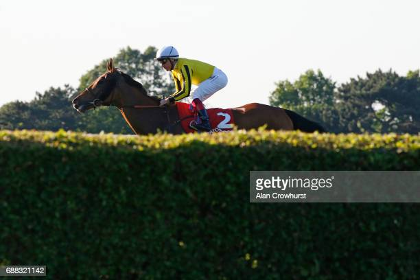Frankie Dettori riding Big Orange on their way to winning The Matchbook VIP Henry II Stakes at Sandown Park on May 25 2017 in Esher England