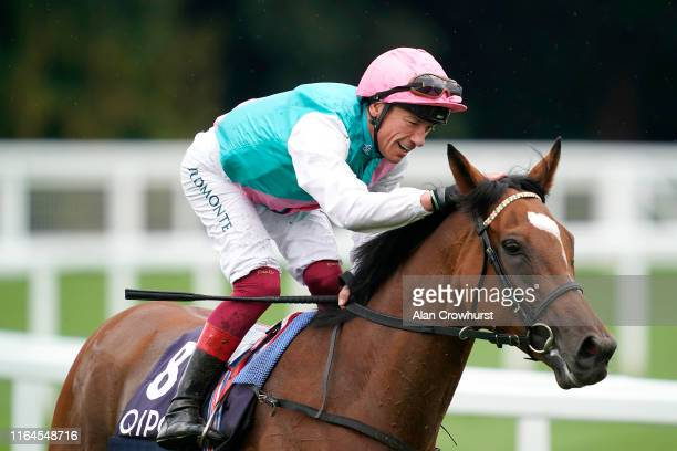 Frankie Dettori riding Enable celebrates after winning The King George VI And Queen Elizabeth Qipco Stakes at Ascot Racecourse on July 27, 2019 in...