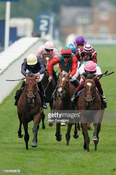 Frankie Dettori riding Enable win The King George VI And Queen Elizabeth Qipco Stakes from Crystal Ocean and James Doyle at Ascot Racecourse on July...