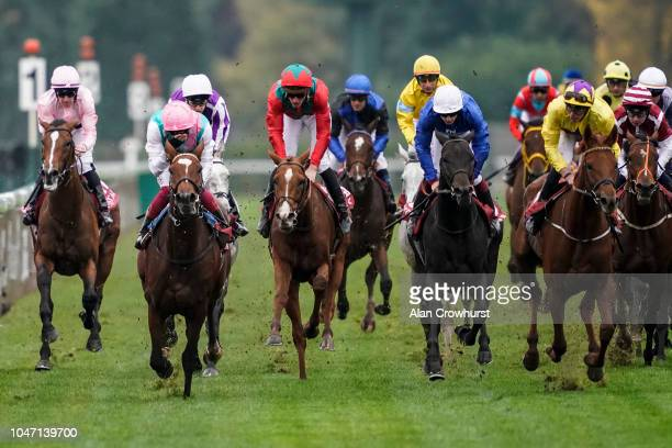 Frankie Dettori riding Enable win The Qatar Prix de l'Arc de Triomphe from Sea Of Class and James Doyle during the Grand Prix de l'Arc de Triomphe at...