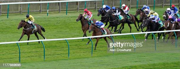 Frankie Dettori riding Lord North win The bet365 Cambridgeshire Handicap from Beringer and Thor Hammer Hansen at Newmarket Racecourse on September...
