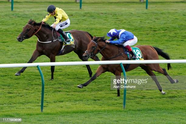 Frankie Dettori riding Lord North win The bet365 Cambridgeshire Handicap from Beringer and Thor Hammer Hansen at Newmarket Racecourse on September 28...