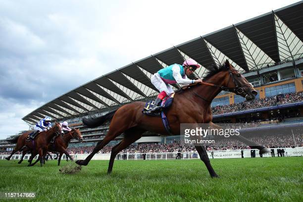 Frankie Dettori riding Sangarius leads the field on his way to winning The Hampton Court Stakes on day three of Royal Ascot at Ascot Racecourse on...