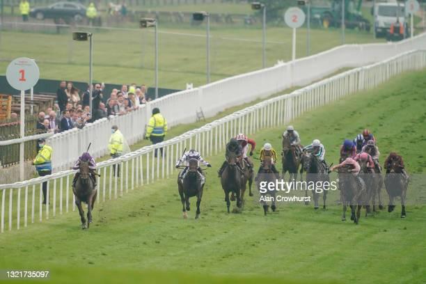 Frankie Dettori riding Snowfall win The Cazoo Oaks by sixteen lengths at Epsom Racecourse on June 04, 2021 in Epsom, England. Due to the Coronavirus...