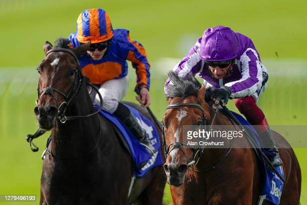 Frankie Dettori riding St Mark's Basillica win The Darley Dewhurst Stakes from Ryan Moore and Wembley at Newmarket Racecourse on October 10, 2020 in...