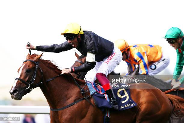 Frankie Dettori riding Stradivarius celebrates winning The Gold Cup as he crosses the line on day 3 of Royal Ascot at Ascot Racecourse on June 21...