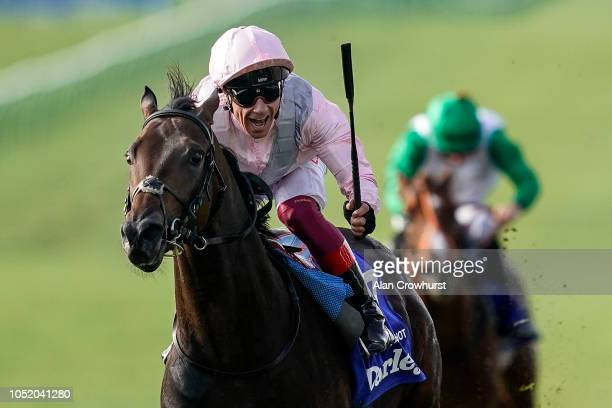 Frankie Dettori riding Too Darn Hot celebrate early as they win The Darley Dewhurst Stakes at Newmarket Racecourse on October 13 2018 in Newmarket...