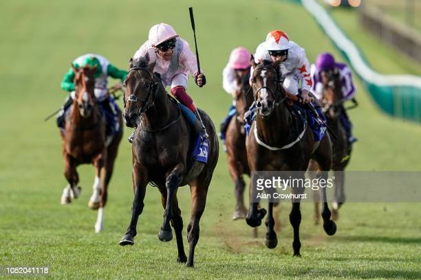Frankie Dettori riding Too Darn Hot celebrates early as they win The Darley Dewhurst Stakes at Newmarket Racecourse on October 13 2018 in Newmarket...
