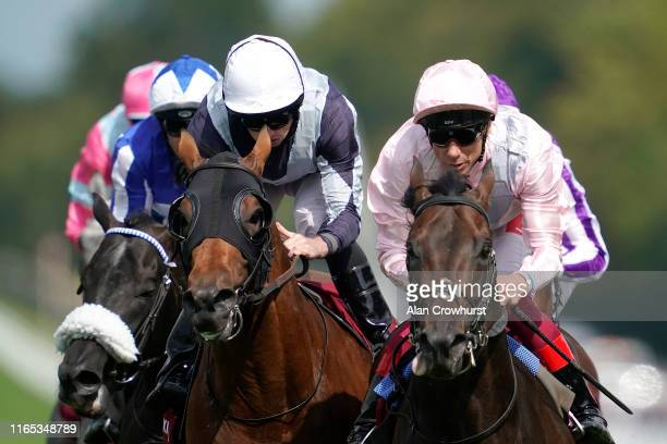 Frankie Dettori riding Too Darn Hot ease down after winning The Qatar Sussex Stakes from Circus Maximus at Goodwood Racecourse on July 31, 2019 in...