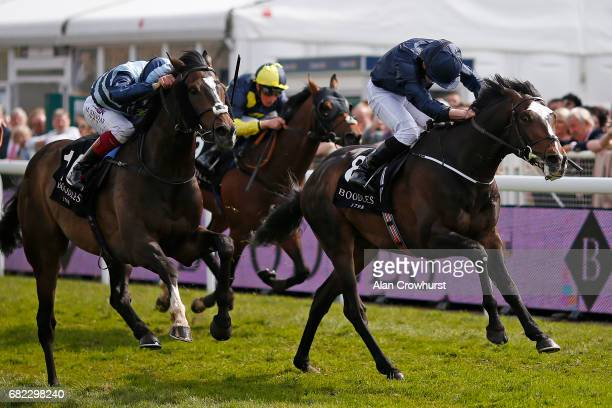 Frankie Dettori riding Western Hymn win The Boodles Diamond Ormonde Stakes from US Army Ranger at Chester Racecourse on May 12 2017 in Chester England