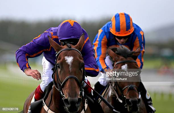 Frankie Dettori riding Wicklow Brave win The Palmerstown House Estate Irish St Leger from Order Of St George at Curragh racecourse on September 11...