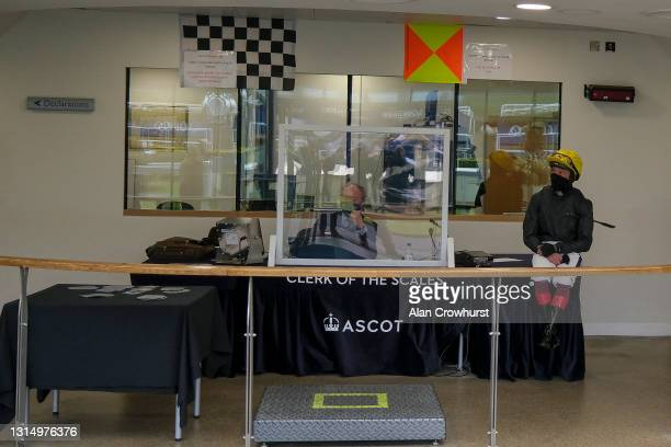 Frankie Dettori sits on a desk in the weighing room before riding Stradivarius to win The Longines Sagaro Stakes at Ascot Racecourse on April 28,...