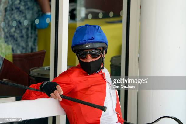 Frankie Dettori waits outside the weighing room at Goodwood Racecourse on July 31 2020 in Chichester England Owners are allowed to attend if they...