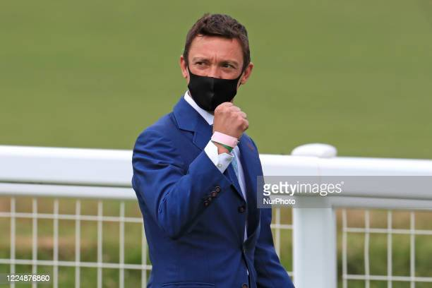 Frankie Dettori walks the course on Epsom Downs south of London on July 4 2020 and fist pumps his supporters prior to the 241st Epsom Derby which was...