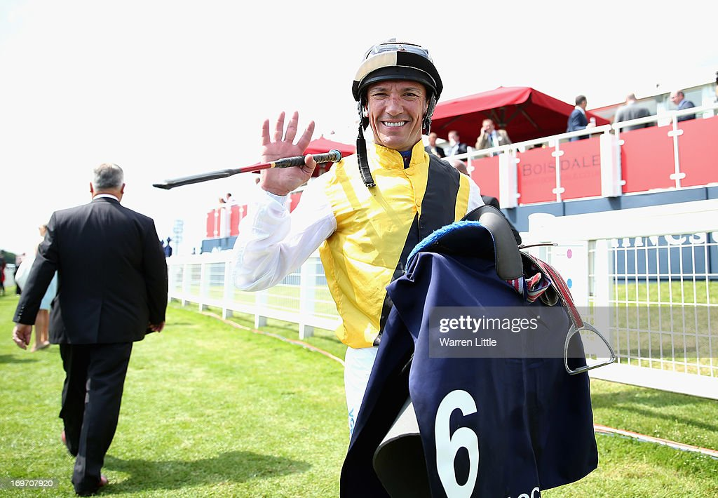 Frankie Dettori waves to the camera after finishing The Investec Diomed Stakes and his last race of the day during Epsom Races at Epsom Racecourse on May 31, 2013 in Epsom, England.