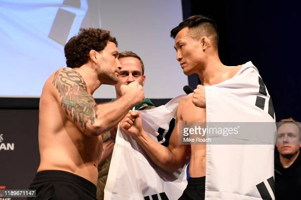 Frankie Edgar and Chan Sung Jung of South Korea face off during the UFC fight night weighin at Sajik Arena on December 20 2019 in Busan South Korea
