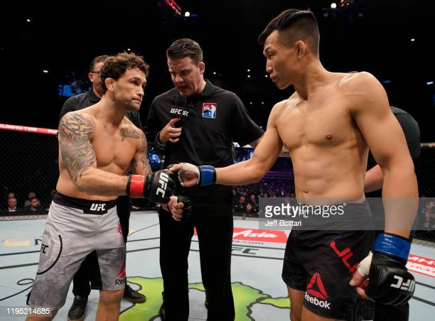 Frankie Edgar and Chan Sung Jung of South Korea face off prior to their featherweight fight during the UFC Fight Night event at Sajik Arena 3 on...
