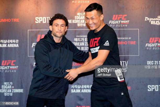 Frankie Edgar and Chan Sung Jung of South Korea interact during the UFC Fight Night Ultimate Media Day at Lotte Hotel Busan on December 19 2019 in...