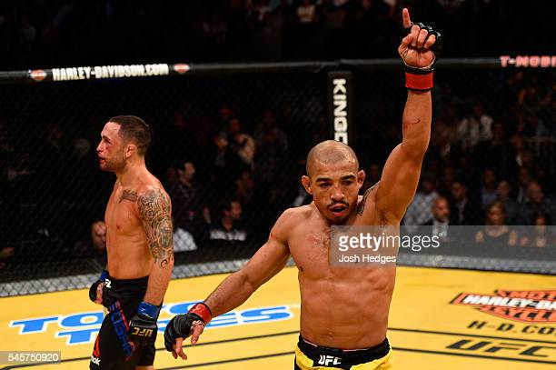 Frankie Edgar and Jose Aldo of Brazil react after their UFC interim featherweight championship bout during the UFC 200 event on July 9 2016 at...