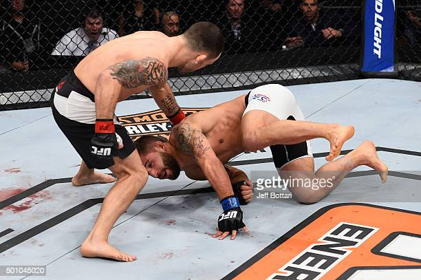 Frankie Edgar punches Chad Mendes in their featherweight bout during the TUF Finale event inside The Chelsea at The Cosmopolitan of Las Vegas on...