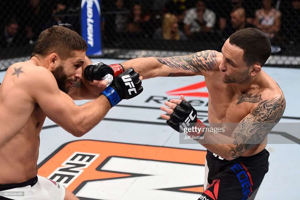 Frankie Edgar punches Chad Mendes in their featherweight bout during the TUF Finale event inside The Chelsea at The Cosmopolitan of Las Vegas on December 11, 2015 in Las Vegas, Nevada.